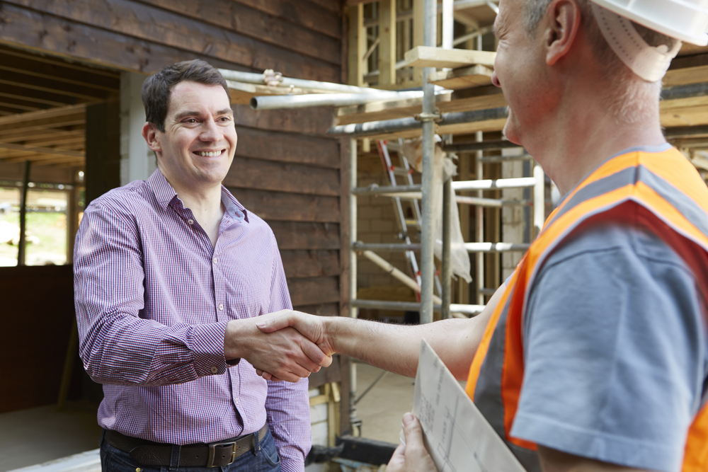 The Significance of Hiring Professional New Home Builders handshake