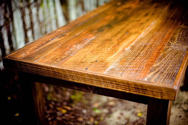 A dusty, scratched wooden table.